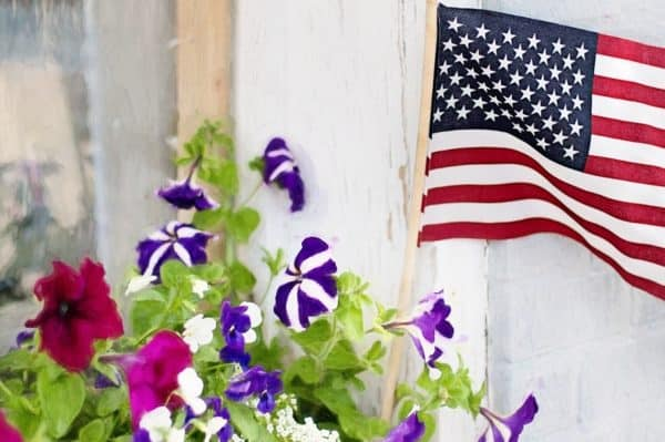 American flag and flowers
