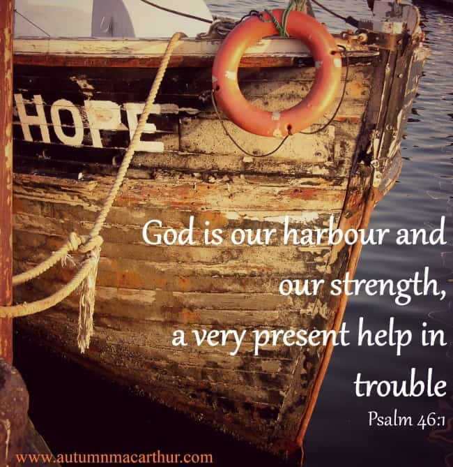 Image of an old wooden ship named Hope at the dockside. Text: God is our harbour and our strength, a very present help in trouble. Psalm 46:1. From inspirational romance author Autumn Macarthur
